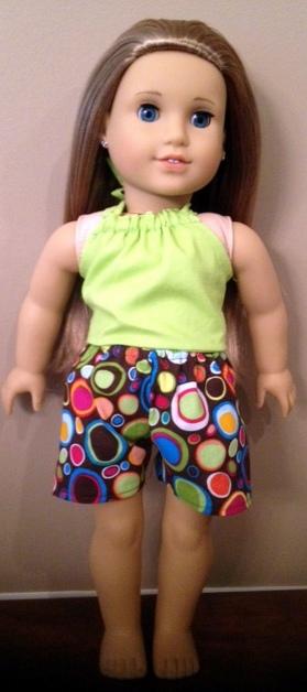 Sports shorts and halter top on McKenna