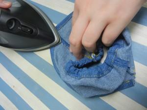 Dakato ironing her shorts
