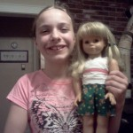 Amy and her doll wearing her sports shorts