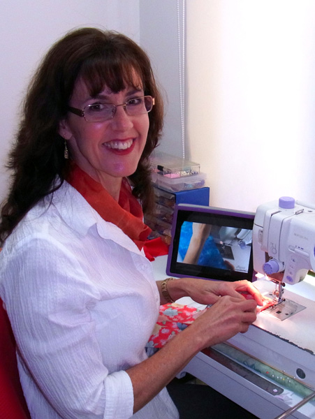 Rosanne at sewing machine with IPAD