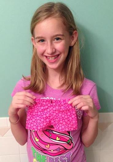 Sashas daugher with the shorts she made all by herself
