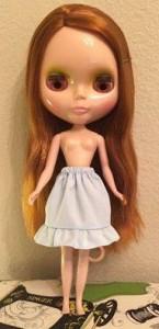 Tai making doll clothes