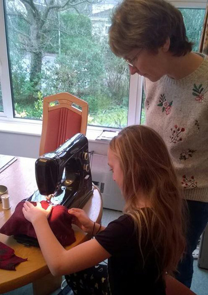Ruth and granddaughter sewing lessons